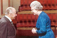 H.M. The Queen awarding the OBE to Lt. Col. Gray